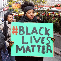 Woman holding Black Lives Matter sign