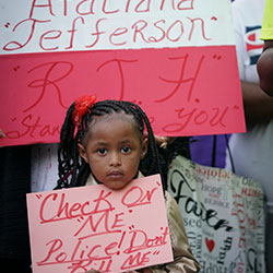 Trinity Ford, 4, joins the crowd gathered during a community vigil for Atatiana Jefferson on Sunday, Oct. 13, 2019, in Fort Worth, Texas.