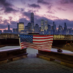 A U.S. flag hangs from a steel girder, damaged in the Sept. 11, 2001 attacks on the World Trade Center, at a memorial in Jersey City, N.J., Sept. 11, 2019