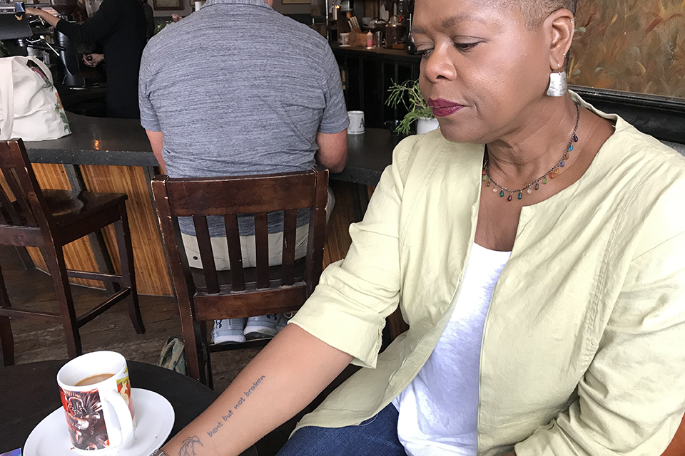 Dolores Bennett shows the tattoo she got last month on what would have been her daughter Devan's 30th birthday. Bennett's daughter died by suicide two years ago. Photo by Christen McCurdy.