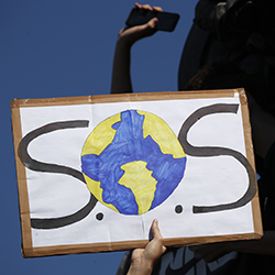 A protester shows a placard during a climate demonstration Friday, Sept. 20, 2019 in Paris. In Canberra and Kabul, Cape Town and Berlin, and across the globe, hundreds of thousands of people took the streets Friday to demand that leaders tackle climate change in the run-up to a U.N. summit. (AP Photo/Francois Mori)