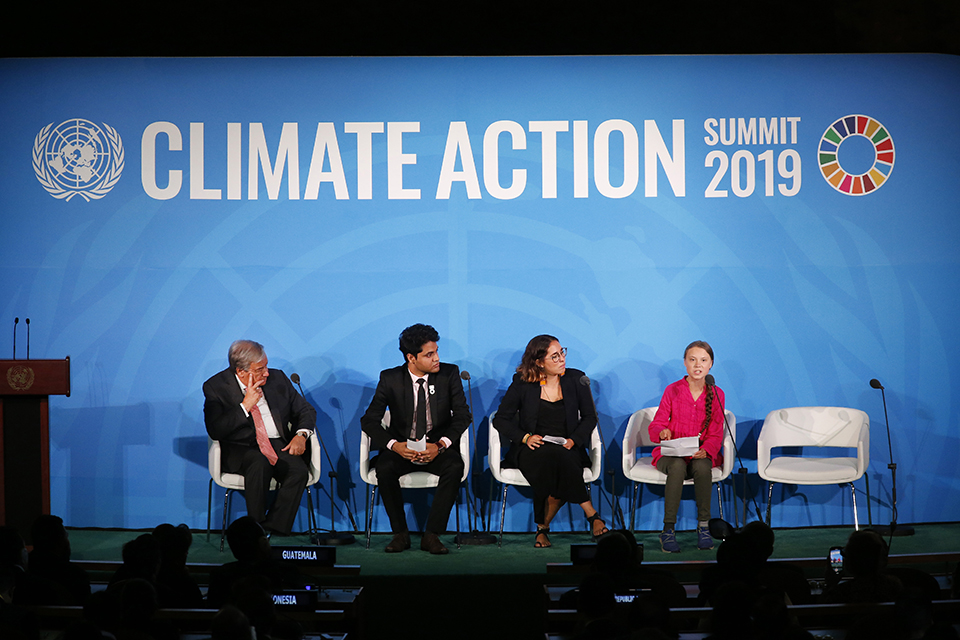 United Nations Secretary-General Antonio Guterres, far left, and young environmental activists look on as Greta Thunberg, of Sweden, far right, addresses the Climate Action Summit in the United Nations General Assembly, at U.N. headquarters, Monday, Sept. 23, 2019. (AP Photo/Jason DeCrow)