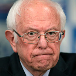 In this March 12, 2020, file photo Democratic presidential candidate, Sen. Bernie Sanders, I-Vt., speaks to reporters about coronavirus in Burlington, Vt. (AP Photo/Charles Krupa, File)