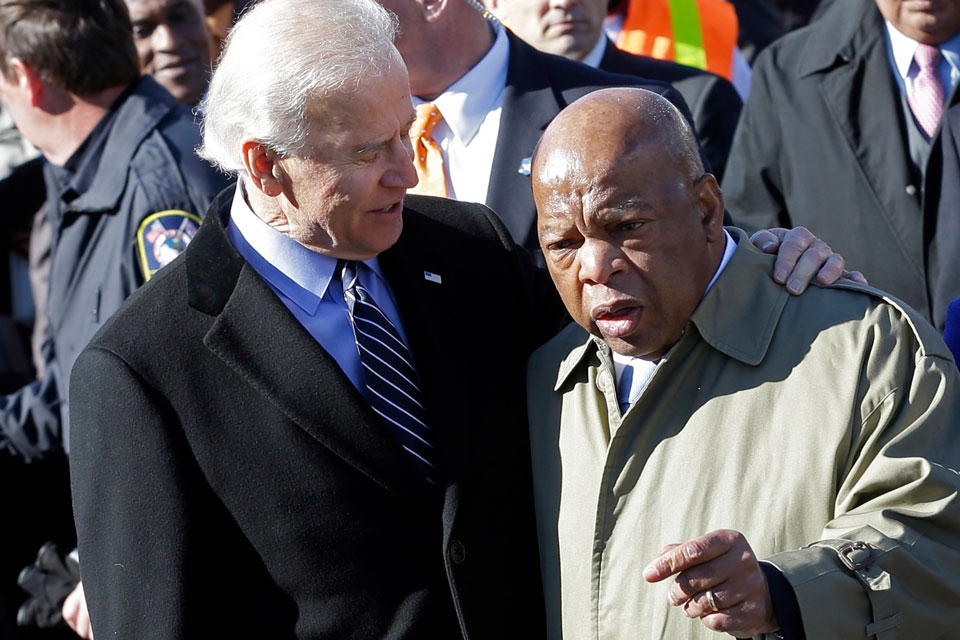 "In this March 3, 2013, file photo, Vice President Joe Biden, left, embraces U.S. Rep. John Lewis, D-Ga., as they prepare to lead a group across the Edmund Pettus Bridge in Selma, Ala. Civil rights icon Lewis is backing Biden for president, giving the prospective Democratic nominee perhaps his biggest symbolic endorsement among the many veteran black lawmakers who back his candidacy. ""We need his voice,"" the 80-year-old Lewis told reporters ahead of the campaign's Tuesday, April 7, 2020 announcement. (AP Photo/Dave Martin, File)"