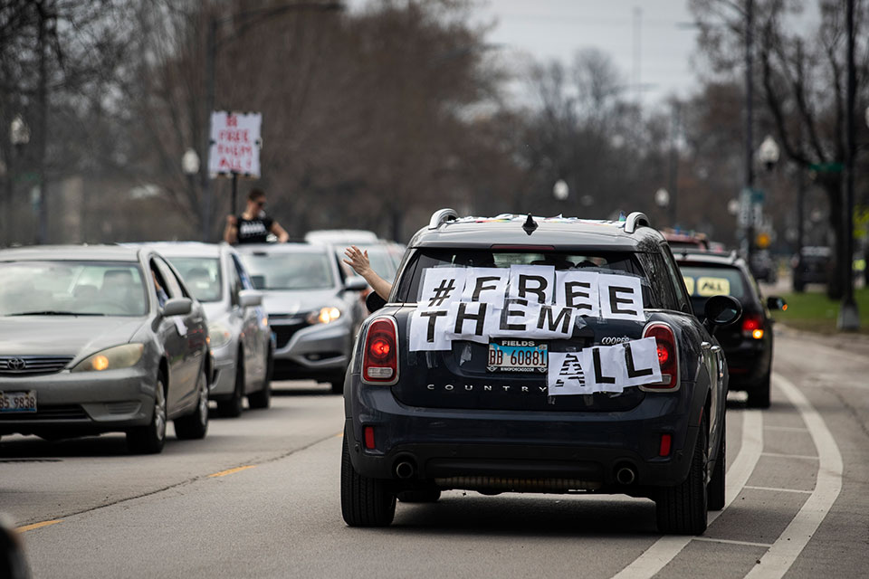 Amid fears of the coronavirus pandemic, dozens of protesters drive around Cook County Jail and the Leighton Criminal Courthouse, in Chicago honking their horns and chanting to demand the
