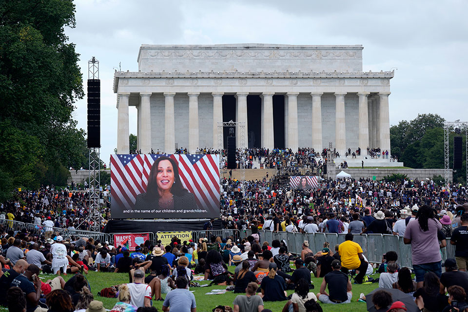 "A screen displays a video with Democratic vice presidential candidate Kamala Harris speaking during the March on Washington, Friday Aug. 28, 2020, at the Lincoln Memorial in Washington, on the 57th anniversary of the Rev. Martin Luther King Jr.'s ""I Have A Dream"" speech. (AP Photo/Carolyn Kaster)"