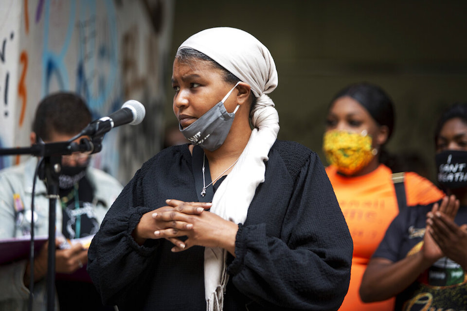Teressa Raiford, executive director of Don't Shoot Portland, speaks in front of a crowd gathered in front of the Mark O. Hatfield Federal Courthouse in downtown Portland, Ore., on July 17, 2020, with several religious leaders calling for non-violent protests and greater accountability from local and federal officials. Other speakers called for an end to racial injustice. Protests in Portland have topped the headlines for days, but lost in the shouting are the voices of Black residents themselves. Their feelings about the unrest are nuanced and diverse. (Brooke Herbert/The Oregonian via AP)