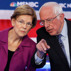 Democratic presidential candidates, Sen. Elizabeth Warren and Sen. Bernie Sanders talk during a Democratic presidential primary debate Wednesday, Feb. 19, 2020. (AP Photo/John Locher)