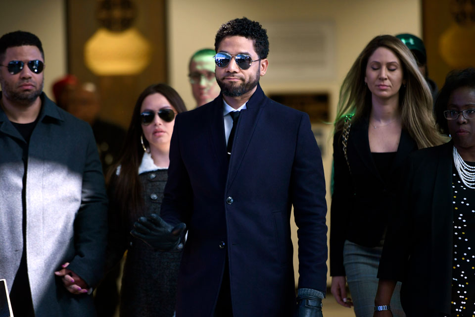 In this March 26, 2019 file photo, actor Jussie Smollett gestures as he leaves Cook County Court after his charges were dropped in Chicago. Smollett faces new charges for reporting an attack that Chicago authorities contend was staged to garner publicity, according to media reports Tuesday, Feb. 11, 2020. The charges include disorderly conduct counts, according to the reports that cite unidentified sources