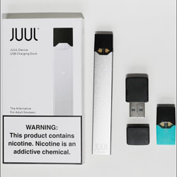 An electronic cigarette kit and mentol pod from Juul Labs is seen on Tuesday, Feb. 25, 2020, in Pembroke Pines, Fla. (AP Photo/Brynn Anderson)