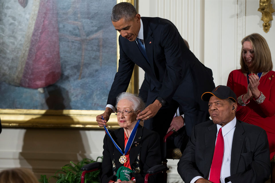 Willie Mays, right, looks on as President Barack Obama presents the Presidential Medal of Freedom to NASA mathematician Katherine Johnson during a ceremony in the East Room of the White House, in Washington. Johnson, a mathematician on early space missions who was portrayed in film Hidden Figures, about pioneering black female aerospace workers, died Monday, Feb. 24, 2020