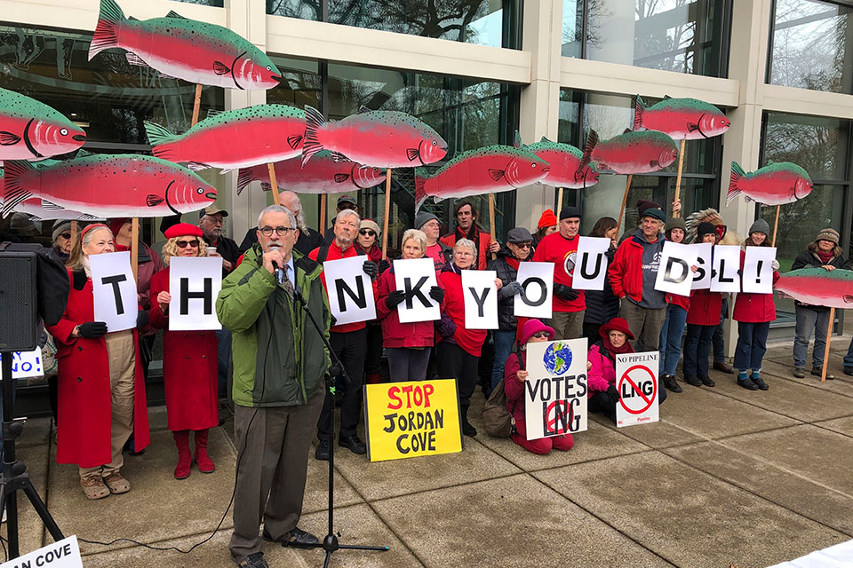 Oregon state Sen. Jeff Golden speaks to demonstrators opposed to a plan to build a natural gas pipeline and marine export terminal in Oregon, at the Department of State Lands in Salem, Ore., Tuesday, Feb. 4, 2020. Golden said he expects the battle to go to the courts if the Trump administration tries to ram the project through despite denials of state permits. Demonstrators held signs depicting salmon, which environmentalists say are among fish species that would be impacted by the proposed 230-mile (370-kilometer) feeder pipeline and export terminal