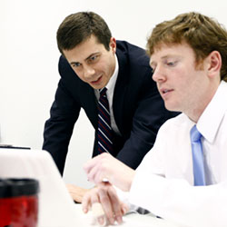 In this Nov. 8, 2011 file photo, Pete Buttigieg looks over return numbers with his campaign manager Mike Schmuhl in South Bend, Ind.