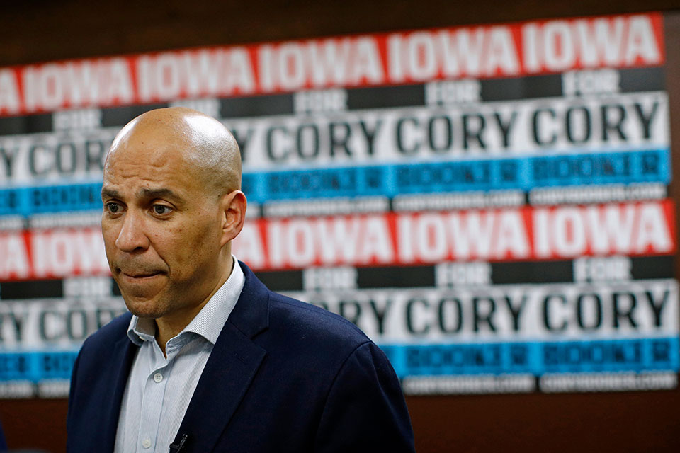 In this Jan. 9, 2020 file photo, Democratic presidential candidate Sen. Cory Booker, D-N.J., speaks with attendees after a campaign event in Mount Vernon, Iowa. Booker has dropped out of the presidential race after failing to qualify for the December primary debate