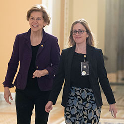 Sen. Elizabeth Warren, D-Mass., center, walks to the Senate chamber for the impeachment trial of President Donald Trump at the Capitol, Thursday, Jan. 23, 2020, in Washington.
