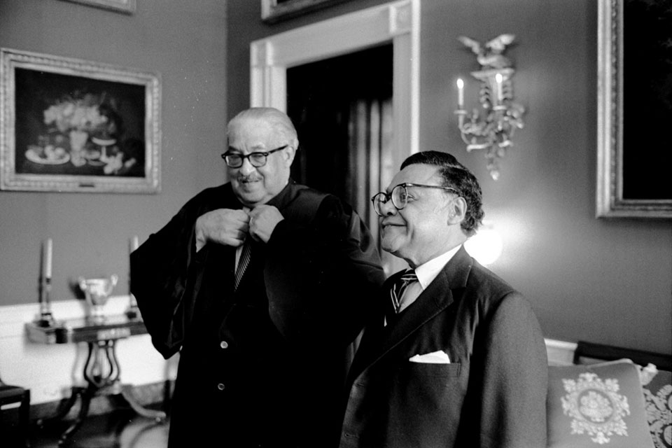Justice Thurgood Marshall and William T. Coleman gather in the Red Room prior to Coleman being sworn in as Secretary of Transportation on March 7, 1975.