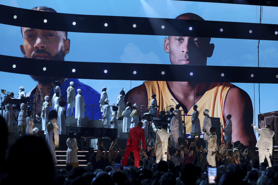 John Legend, Kirk Franklin, DJ Khaled and Meek Mill point to a screen showing Nipsey Hussle and Kobe Bryant during a tribute at the 62nd annual Grammy Awards on Sunday, Jan. 26, 2020, in Los Angeles. (Photo by Matt Sayles/Invision/AP)