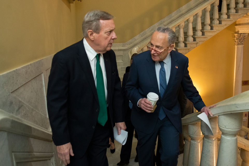 Democratic leader Sen. Chuck Schumer, D-N.Y., right, and Sen. Dick Durbin, D-Ill., walk on the steps in the U.S. Capitol on the first full day of the impeachment trial of President Donald Trump on charges of abuse of power and obstruction of Congress in Washington, Tuesday, Jan. 21, 2020