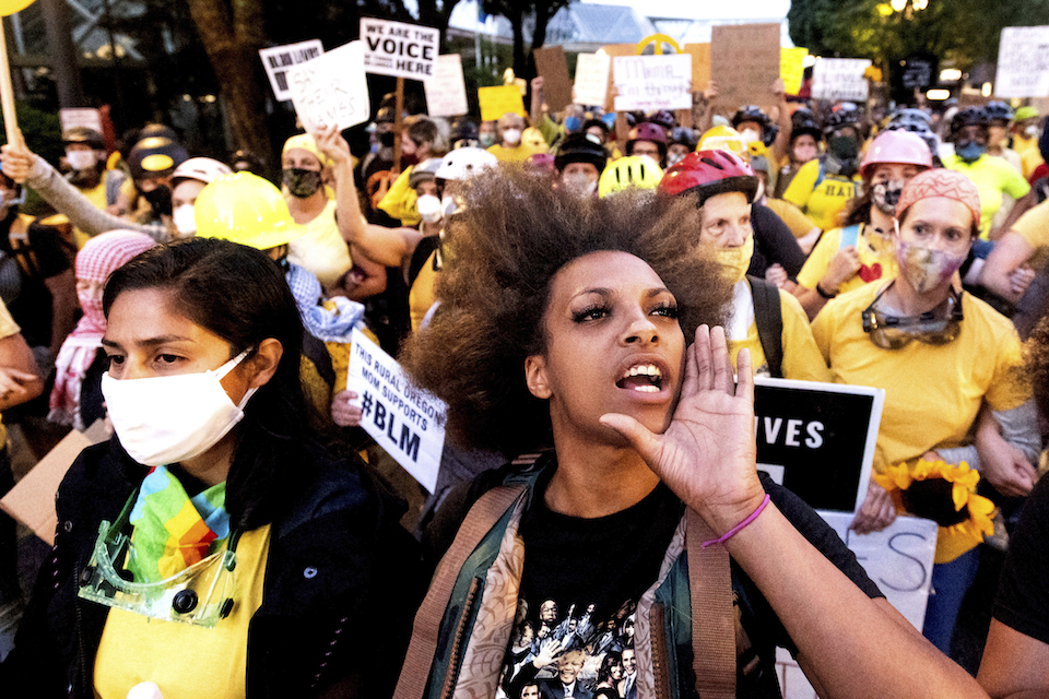 Black Lives Matter organizer Teal Lindseth, 21, leads protesters on Thursday, July 23, 2020, in Portland, Ore. (AP Photo/Noah Berger)