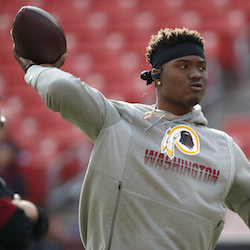 Washington Redskins quarterback Dwayne Haskins works out prior to an NFL football game against the New York Giants, in Landover, Md., Dec. 22, 2019. A new name must still be selected for the Washington Redskins football team, one of the oldest and most storied teams in the National Football League, and it was unclear how soon that will happen. But for now, arguably the most polarizing name in North American professional sports is gone at a time of reckoning over racial injustice, iconography and racism in the U.S. (AP Photo/Alex Brandon, File)