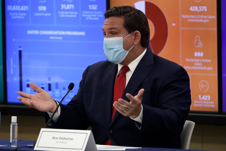 Florida Gov. Ron DeSantis speaks during a roundtable discussion with Miami-Dade County mayors during the coronavirus pandemic, Tuesday, July 14, 2020, in Miami. (AP Photo/Lynne Sladky)