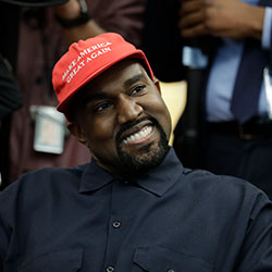 Rapper Kanye West wears a Make America Great again hat during a meeting with President Donald Trump in the Oval Office of the White House in Washington on Oct. 11, 2018.