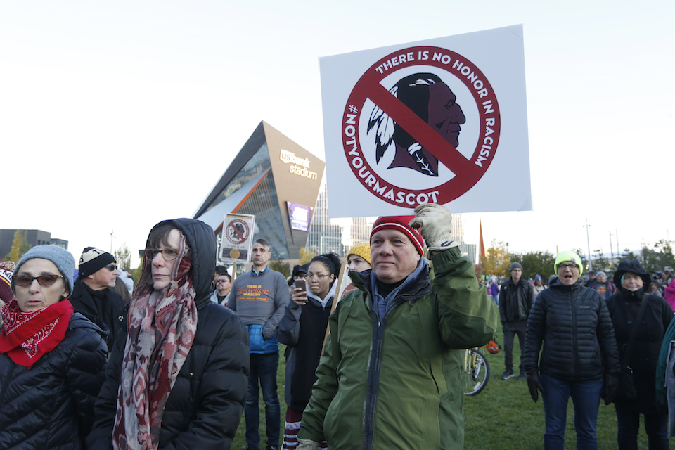 Native American leaders protest against the Redskins team name outside U.S. Bank Stadium before an NFL football game between the Minnesota Vikings and the Washington Redskins in Minneapolis, Oct. 24, 2019. A new name must still be selected for the Washington Redskins football team, one of the oldest and most storied teams in the National Football League, and it was unclear how soon that will happen. But for now, arguably the most polarizing name in North American professional sports is gone at a time of reckoning over racial injustice, iconography and racism in the U.S. (AP Photo/Bruce Kluckhohn, File)
