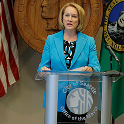 Seattle Mayor Jenny Durkan, center, speaks Monday, July 13, 2020