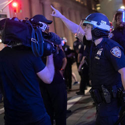 A police officer shouts at Associated Press videojournalist Robert Bumsted, Tuesday, June 2, 2020, in New York. New York City police officers surrounded, shoved and yelled expletives at two Associated Press journalists covering protests Tuesday in the latest aggression against members of the media during a week of unrest around the country. Portions of the incident were captured on video by Bumsted, who was working with photographer Wong Maye-E to document the protests in lower Manhattan over the killing of George Floyd in Minneapolis. (AP Photo/Wong Maye-E)