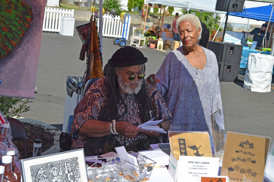 An artist displays his work at the Alberta Commons grand opening celebration in NE Portland which took place on July 20, 2019 on NE Alberta St and NE Martin Luther King Jr. Blvd. (Photo by Jerry Foster)
