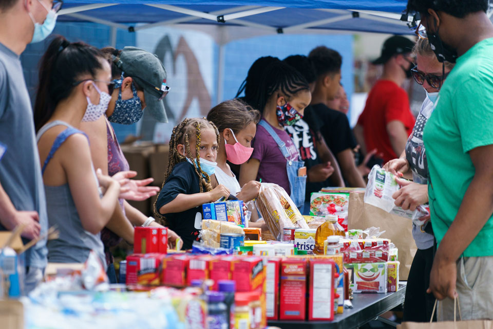 Young volunteers, from center left, Madelyn Brown, 7, Chayce Goldate, 9, and Alicia Carter, 11, help distribute food at the Everybody Eats Juneteenth Food Drive, at the Universal Daroff Charter School, Friday, June 19, 2020, in Philadelphia. Friday marks Juneteenth, the day in 1865 when federal troops arrived in Galveston, Texas to take control of the state and ensure all enslaved people be freed, more than two years after the Emancipation Proclamation. (Jessica Griffin/The Philadelphia Inquirer via AP)