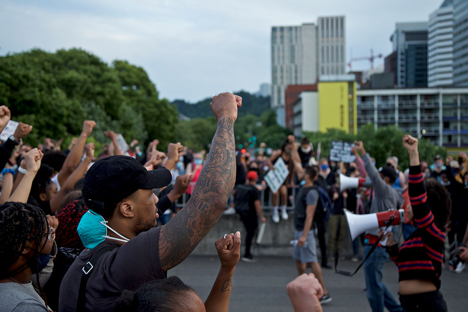 Portland Trail Blazers' Damian Lillard, left, joins other demonstrators in Portland, Ore., during a protest against police brutality and racism, sparked by the death of George Floyd, who died May 25 after being restrained by police in Minneapolis. (AP Photo/Craig Mitchelldyer)