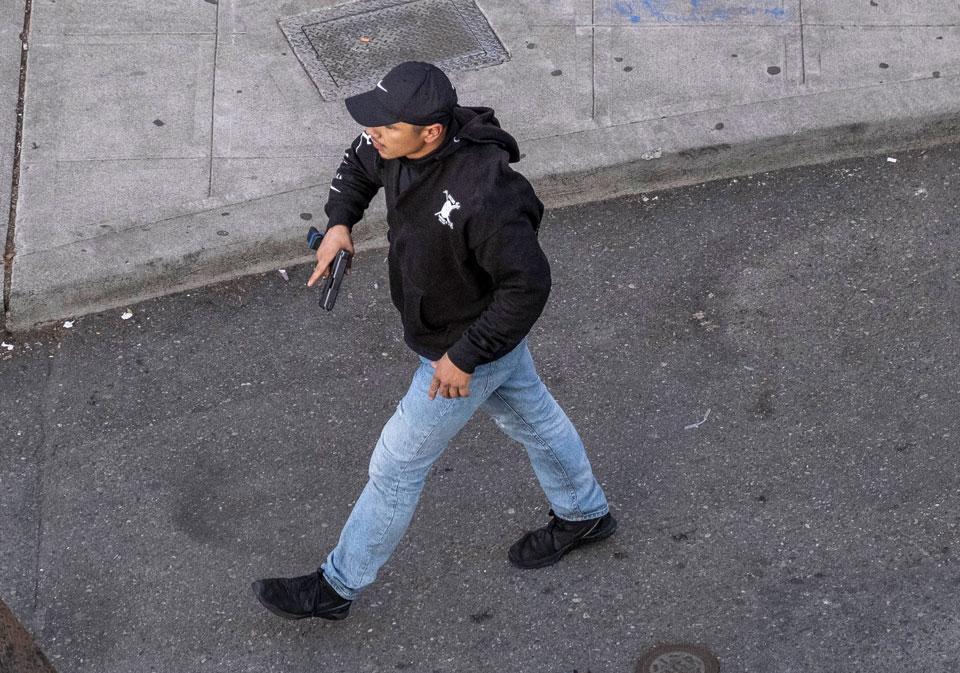 seattle tear gas streets man with gun