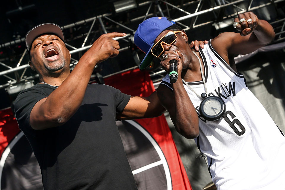 This May 29, 2015 file photo shows Chuck D, left, Flavor Flav of Public Enemy performing at the 2015 BottleRock Napa Valley Music Festival in Napa, Calif. Public Enemy has abruptly fired founding member Flavor Flav following a public spat over the rap group's plan to perform at a Bernie Sanders campaign event. (Photo by Rich Fury/Invision/AP, File)