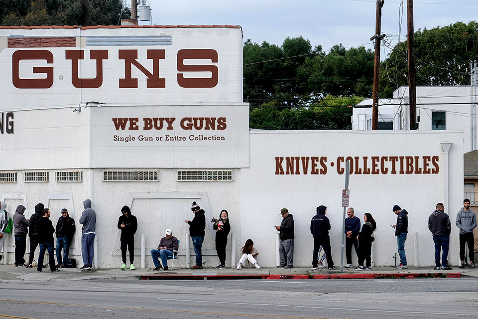 People wait in a line to enter a gun store in Culver City, Calif., March 15, 2020. (AP Photo/Ringo H.W. Chiu)