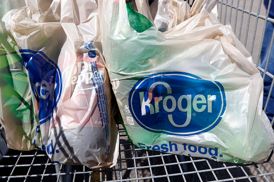 In this June 15, 2017, file photo, bagged purchases from the Kroger grocery store in Flowood, Miss., sit inside this shopping cart. A group of Instacart workers are organizing a strike across the U.S. starting Monday, March 30, 2020, to demand more pay and protection as they struggle to meet a surge in demand for grocery deliveries during the coronavirus pandemic. It was unclear how many of Instacart's shoppers - most of whom work as independent contractors - would join the strike.