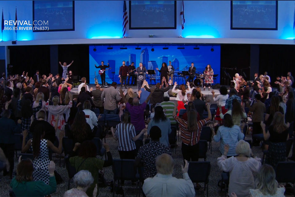 This image is a screenshot of the live video of The River at Tampa Bay Church's Sunday, March 29, 2020 service violating social distancing orders.
