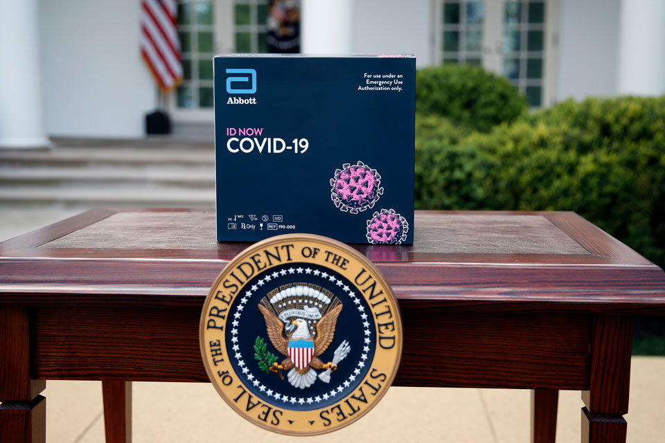 A 5-minute test kit for COVID-19 developed by Abbott Laboratories sits on a table ahead of a briefing by President Donald Trump about the coronavirus in the Rose Garden of the White House, Monday, March 30, 2020, in Washington. (AP Photo/Alex Brandon)