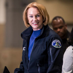 Seattle Mayor Jenny Durkan hands off the mic during a press conference at CenturyLink Field Event Center on Saturday, March 28, 2020, in Seattle, Wash.. (Amanda Snyder/The Seattle Times via AP, Pool)