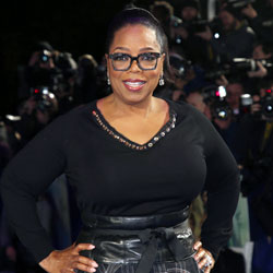 In this March 13, 2018, file photo, actress Oprah Winfrey poses for photographers upon arrival at the premiere of the film