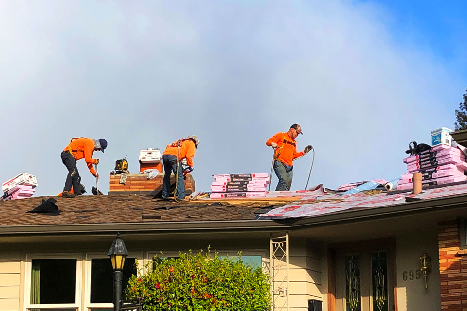 Roofers work on a home in Salem, Ore., Tuesday, May 5, 2020. Oregon Gov. Kate Brown has allowed construction to continue under her stay-home order. (AP Photo/Andrew Selsky)