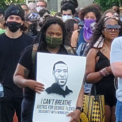 This photo taken at Peninsula Park Friday, May 29 at 6 p.m. shows people gathered to protest the Minneapolis police killing of a Black man George Floyd. A group left the park after the rally and went downtown. Property was damaged and graffiti was painted on many buildings along their route on MLK Blvd. (photo by Jerry Foster)