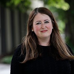In this photo taken Tuesday, May 26, 2020, Dayna Lurie poses for a photo in Seattle. Lurie found out that she was a victim of unemployment benefits fraud when her boss received a notice and called to ask about it. (AP Photo/Elaine Thompson)