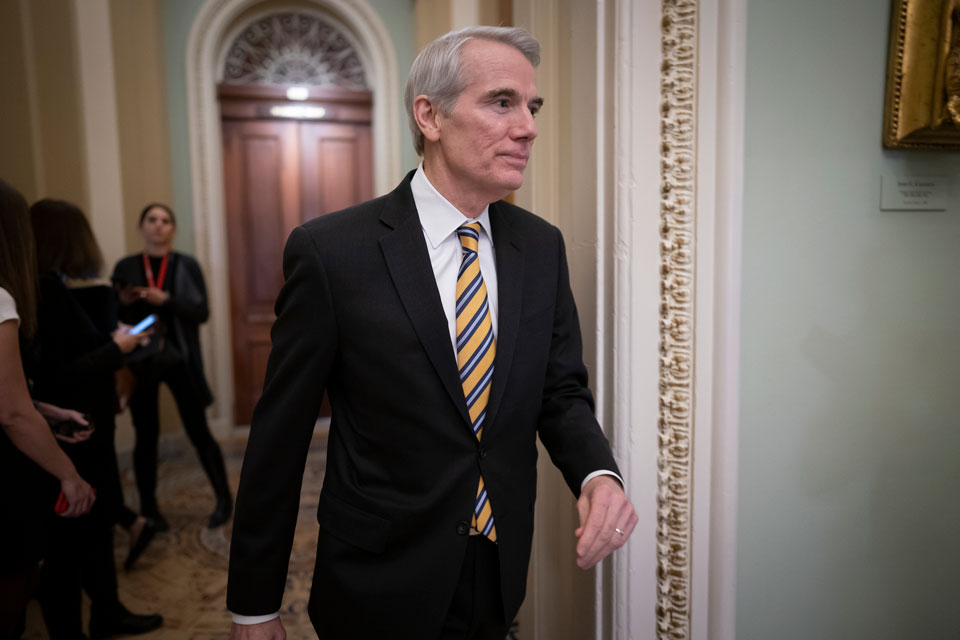 In this Jan. 31, 2020, file photo Sen. Rob Portman, R-Ohio, arrives as the impeachment trial of President Donald Trump on charges of abuse of power and obstruction of Congress resumes in Washington. Pressure is increasing on a Trump administration official to authorize a formal transition process for President-elect Joe Biden. Portman of Ohio on Monday, Nov. 23, called for the head of the General Services Administration to release money and staffing needed for the transition. (AP Photo/J. Scott Applewhite, File)