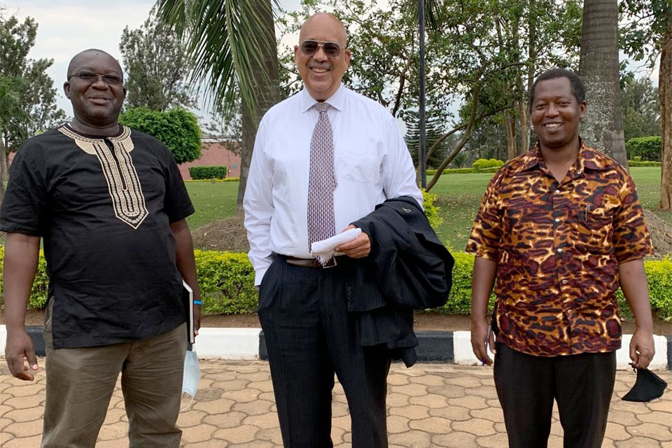 With masks in tow, Dr. Jonathan Weaver (center) stands in Rwanda with Edouard Ndayisaba,CEO, DGrid Energy (left) and Dr. Jean Mfizi, an epidemiologist and deputy vice chancellor for public affairs, Adventist University of Central Africa.