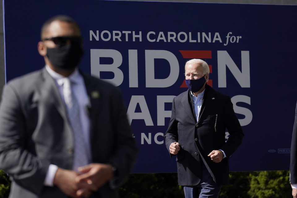 Democratic presidential candidate former Vice President Joe Biden arrives to speak during a campaign event at Riverside High School in Durham, N.C., Sunday, Oct. 18, 2020. (AP Photo/Carolyn Kaster)
