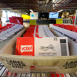 Ballots mailed-in are ready to be sorted at the King County Elections office Tuesday, Oct. 20, 2020, in Renton, Wash.