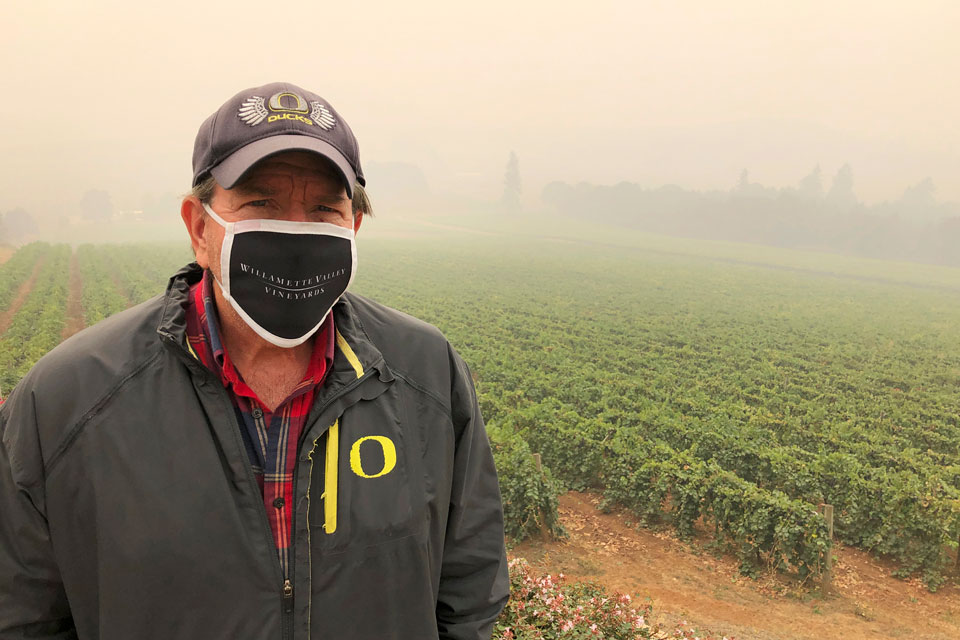 "Jim Bernau, founder and winegrower of Willamette Valley Vineyards, speaks at his winery blanketed in smoke from wildfires on Thursday, Sept. 17, 2020, in Turner, Ore. Bernau said of the smoke: ""I've been here growing wine grapes for over 38 years, and I have never experienced or seen anything like this as a wine grower."" (AP Photo/Andrew Selsky)"