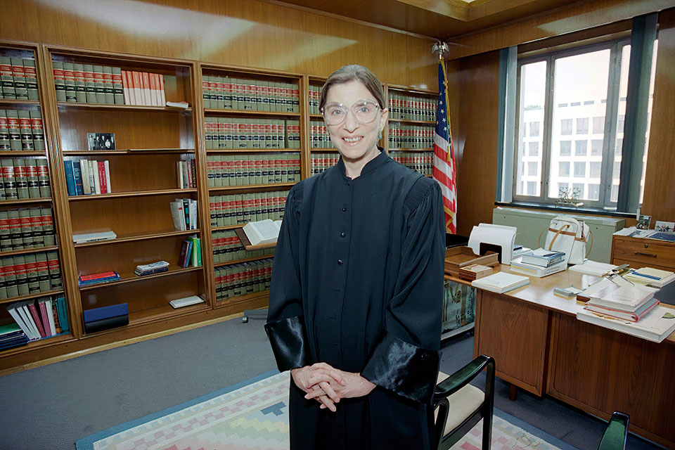 In this Aug. 3, 1993, file photo, then-Judge Ruth Bader Ginsburg poses in her robe in her office at U.S. District Court in Washington. Earlier, the Senate voted 96-3 to confirm Bader as the 107th justice and the second woman to serve on the Supreme Court. Ruth Bader Ginsburg died at her home in Washington, on Sept. 18, 2020, the Supreme Court announced. (AP Photo/Doug Mills, File)