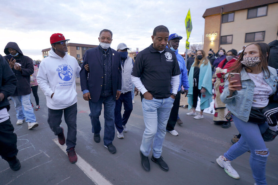 The Rev. Jesse Jackson, center left, walks with supporters during a protest over the fatal shooting of Daunte Wright by a police officer during a traffic stop, outside the Brooklyn Center Police Department, Saturday, April 17, 2021, in Brooklyn Center, Minn. (AP Photo/Julio Cortez)
